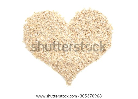 Porridge oats in a heart shape, isolated on a white background - stock photo