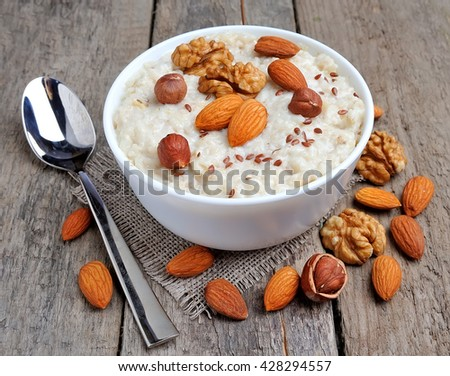 Porridge oats with mix nuts  on wooden tables