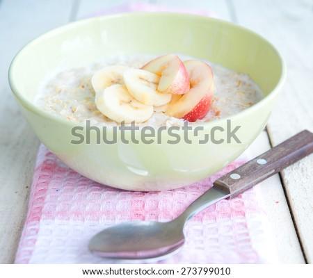 porridge with banana - stock photo