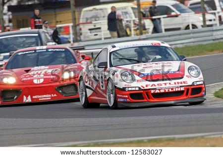 porsche and ferrari race cars - stock photo