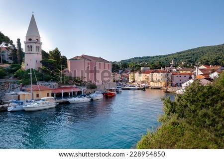 Port and church landscape at Veli losinj - Croatia - stock photo