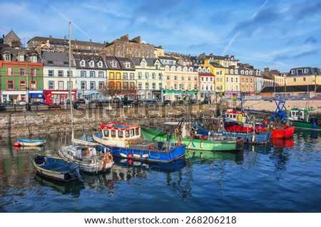 Port and colorful houses in Cobh, Ireland. Famous city and popular touristic destination - stock photo