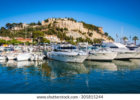 Port and medieval castle in Cassis, France - stock photo