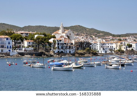 Port and town of Cadaques with Santa Maria church, commune on the Costa Brava at northeastern Catalonia in Spain - stock photo
