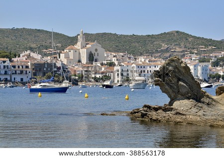Port and town of Cadaques with Santa Maria church in the background. Cadaques is a commune on the Costa Brava at northeastern Catalonia in Spain - stock photo