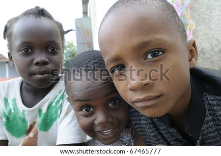 PORT-AU-PRINCE - SEPTEMBER 2:  unidentified Haitian kids  enjoying during a camp, in Port-Au-Prince, Haiti on September 2, 2010.