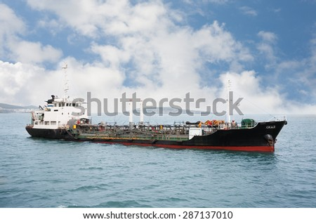 Port bunkering tanker in the waters of Vladivostok. Eastern Bosphorus Strait, Russia. - stock photo