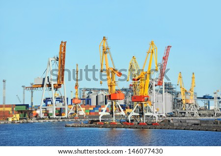 Port cargo crane and container over blue sky background - stock photo