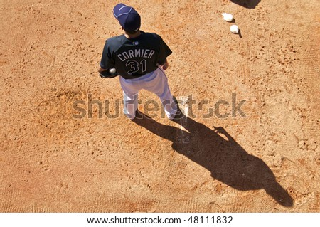 PORT CHARLOTTE, FLORIDA - MARCH 4: Lance Cormier of the Tampa Bay Rays warms up in the bullpen during a game against the Baltimore Orioles on March 4, 2010 in Port Charlotte, Florida - stock photo