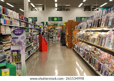 Port Coquitlam, BC Canada - March 17, 2015 : A section display magazines from shelf in supermarket - stock photo