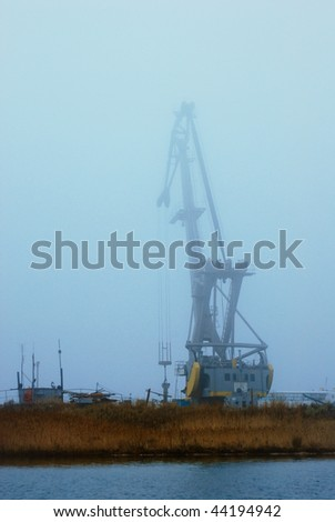 port crane in the foggy twilight