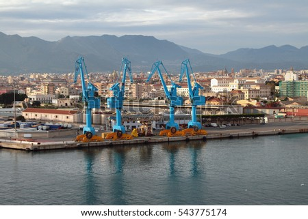 Port cranes and city. Palermo, Italy
