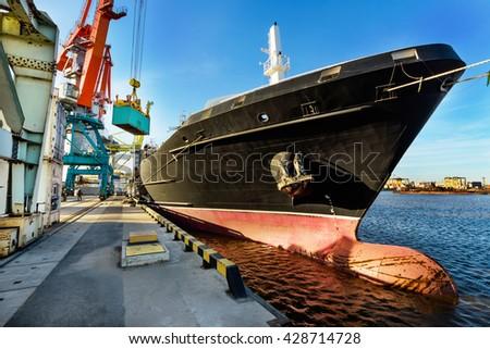 Port cranes and transport ship - stock photo