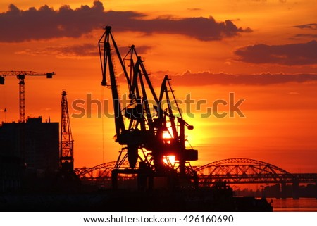 Port cranes at sunset
