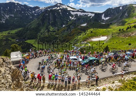 PORT DE PAILLERES,FRANCE- JUL 6: The peloton climbing the road to Col de Pailheres in Pyrenees Mountains during the stage 8 of the 100 edition of Le Tour de France on  July 6, 2013. - stock photo