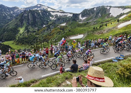 PORT DE PAILLERES,FRANCE- JUL 6: The peloton climbing the road to Col de Pailheres in Pyrenees Mountains during the stage 8 of the 100 edition of Le Tour de France on July 6, 2013