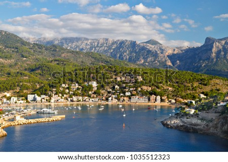 Port de Soller seaside resort in a bay on the coast of Mallorca with Serra de Tramuntana mountains in the background