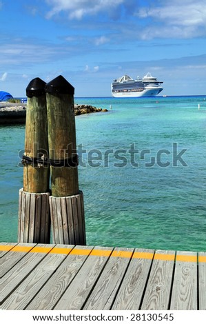 Port deck in Princess Cay Bahamas with cruise ship in background - stock photo