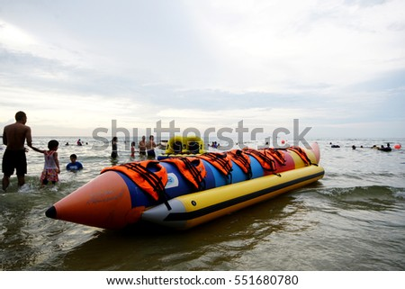 Port Dickson Beach, 25 Dec 2016 - Seascape photo with close up banana boat in the picture when sun was setting down at the horizon