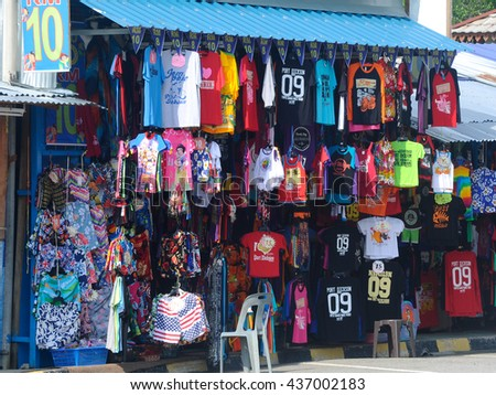 Port Dickson, Malaysia -May 08, 2016: Clothes shop on the beach in Port Dickson, Malaysia. Clothes hung and displayed to attract the attention of buyers.