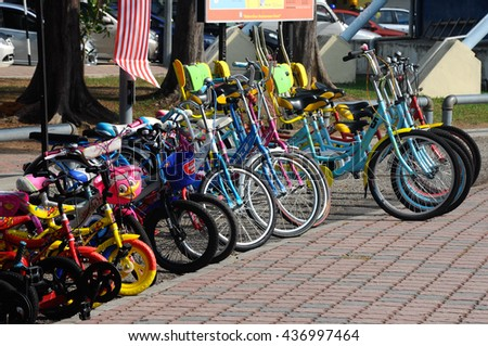 Port Dickson, Malaysia -May 08, 2016: Various types and sizes of bicycles parked on the roadside