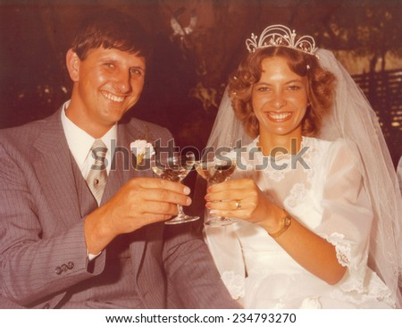 PORT ELIZABETH, SOUTH AFRICA - 1970's: The newly wed couple posing for a photo - stock photo