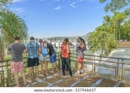 PORT IGUAZU, ARGENTINA, MARCH - 2015 - Tourists enjoying an spectacular view of Iguazu park in the argentinian border.