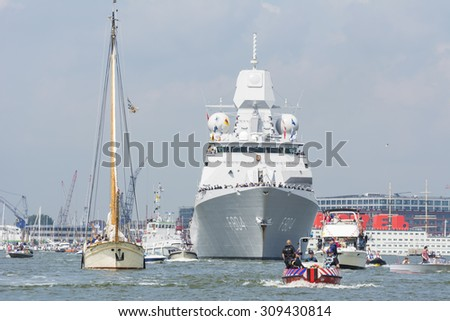 Port of Amsterdam, Noord-Holland/Netherlands - August 19-08-2015 - Dutch navy is sailing to the city of Amsterdam. Plenty small boats sailing in front during the SAIL 2015.