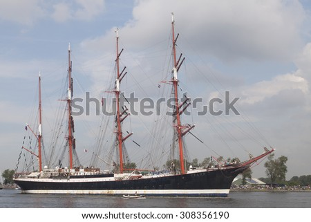 Port of Amsterdam, Noord-Holland,Netherlands - August 19-08-2015 : Tall ship the Sedov  is sailing from IJmuiden to Amsterdam during the big event SAIL on August 19, 2015 Amsterdam , Holland.