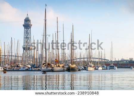 Port of Barcelona, Spain. Yachts, sailing boats and old big tower - stock photo