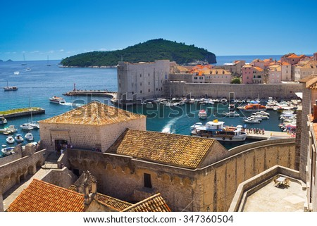 Port of Dubrovnik and red roofs from the old town walls, Croatia - stock photo