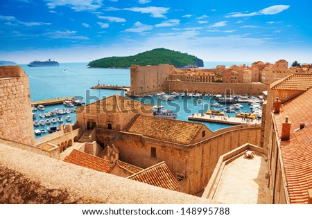 Port of Dubrovnik from the old city walls - stock photo