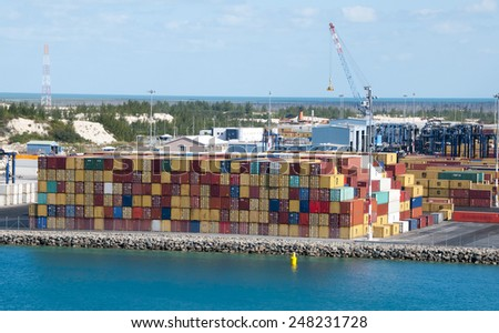 Port of Freeport Bahamas multi colored Container shipyard with deep blue ocean water - stock photo