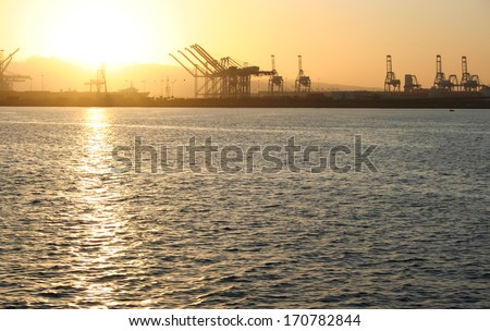 Port of Long Beach Sunset. The Port of Long Beach in southern California during sunset. - stock photo