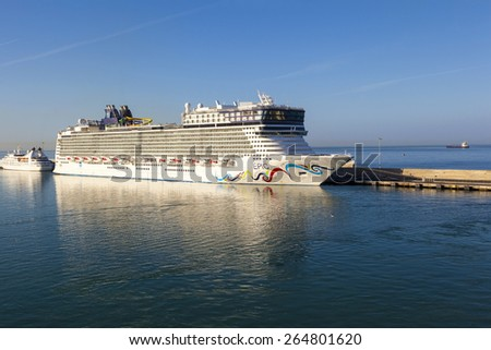 PORT OF ROM ITALY MAY 21: Norwegian Epic, docked in port of Rome (about 80 km of Rome) as seen on May 21 2014. When she was built in 2010, it was the third largest cruise ship in the world.  - stock photo