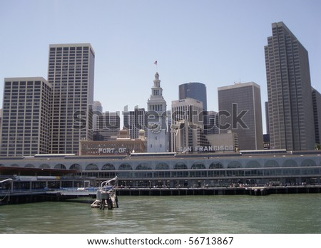 Port of San Francisco Ferry building and cityscape of Downtown San Francisco in the background.  Taken from a ferry departing