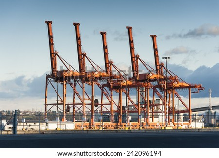 Port of Seattle. Cargo cranes waiting to load containers on ships traveling to ports all over the world. - stock photo