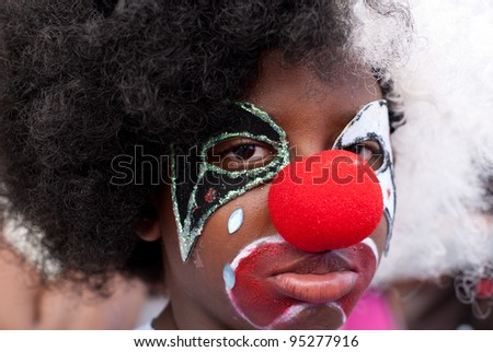 PORT OF SPAIN - FEBRUARY 11: Caleb Phillip portraying a Grumpy Clown during the Red Cross Children's Carnival celebrations on February 11, 2012 in Port Of Spain, Trinidad & Tobago. - stock photo