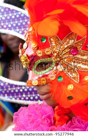 PORT OF SPAIN - FEBRUARY 11: Mahela Brutus playing Mas at the Red Cross Children's Carnival celebrations on February 11, 2012 in Port Of Spain, Trinidad & Tobago.  Exotic costumes are usually on show. - stock photo