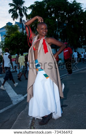 PORT OF SPAIN - MARCH 8: A dancer from the Vulgar Fraction Coalition enjoys Carnival, the largest cultural event in the Anglophone Caribbean March 8, 2011 in Port Of Spain, Trinidad & Tobago. - stock photo