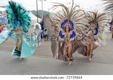 PORT OF SPAIN, TRINIDAD - MARCH 8: Female Masqueraders enjoy themselves in the Harts Carnival presentation 'Planet Rock', March 8, 2011 in Port of Spain, Trinidad.
