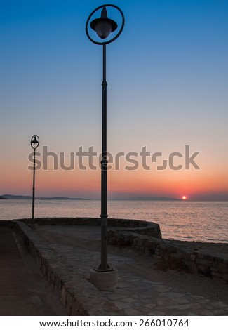 Port street lights at sunset. Mykonos. Greece. - stock photo