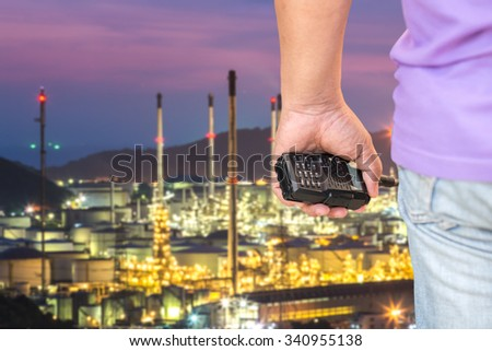Port workers who held radio Background oil plant - stock photo