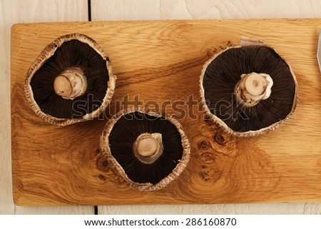 Portabella Mushrooms on a cutting board