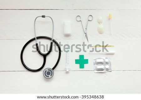 Portable and instrumental retro medical computer on white wooden background