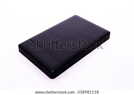 Portable and mobile external hard drive or hard disk HDD isolate - stock photo