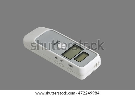 portable breath alcohol tester isolated on gray background closeup