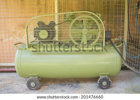 portable compressor near the workshop - stock photo