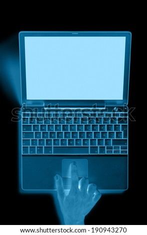 Portable computer with hand and blue tones. Vertical