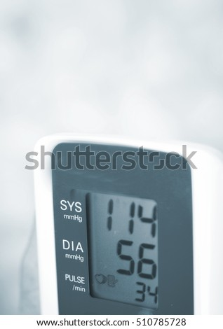 Portable hand held domestic cardiac blood pressure and irregular heart beat pulse rate meter to show resting heart rate in monitored patient.